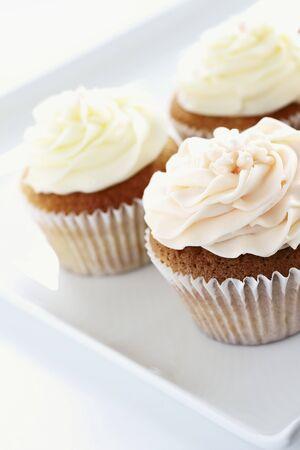 buttercream: Three buttercream cupcakes