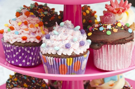 childrens food: Colorful cupcakes for a party on a cake stand