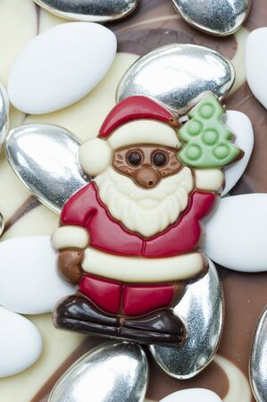 sugared almonds: Chocolate Santa Claus on sugared almonds LANG_EVOIMAGES