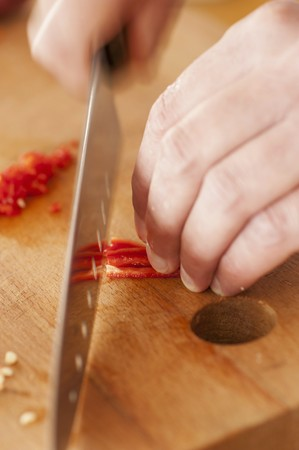 thinly: Thinly slicing red chili peppers