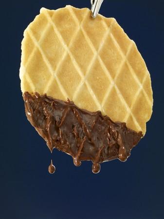 chocolate derretido: Gofrado ba�adas en chocolate derretido