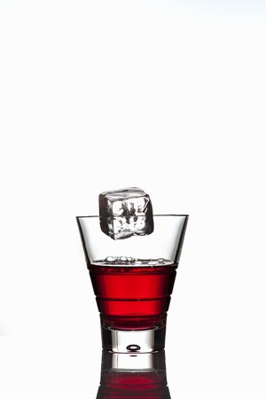 squirted: Ice cube falling into a glass of Campari