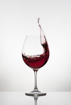 squirted: Red wine spattering out of a glass LANG_EVOIMAGES