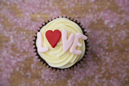 infatuation: Chocolate cupcake with love written on it LANG_EVOIMAGES