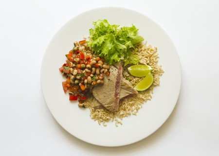 tunafish: Tuna steaks served with a bean and tomato salad and rice LANG_EVOIMAGES