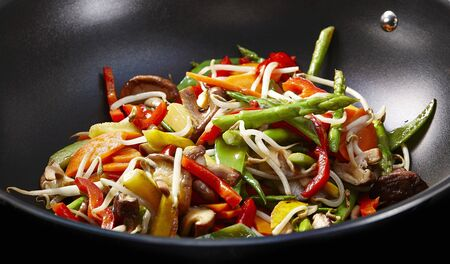 beansprouts: Beansprouts, peppers, shiitake mushrooms and asparagus in a wok
