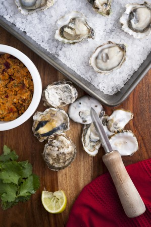 shucked: Preparing Oysters; Whole and Shucked Oysters, Oyster Knife and Chipotle Butter LANG_EVOIMAGES
