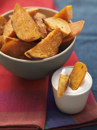 potato wedges: Platter of Baked Sweet Potato Wedges LANG_EVOIMAGES