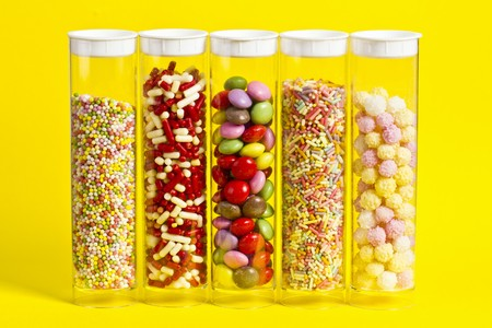 Colourful sugar decorations in sealable plastic tubes