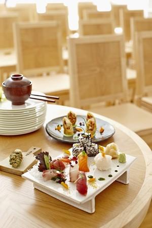 tunafish: A sushi platter with nigiri, maki, Califormia rolls, tuna, salmon, wasabi and ginger in a restaurant LANG_EVOIMAGES