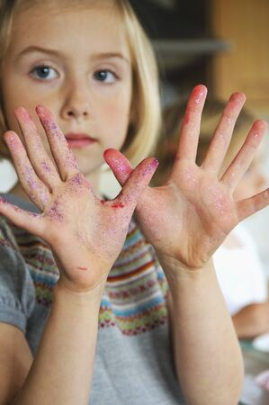 smeared: A girl showing smeared hands