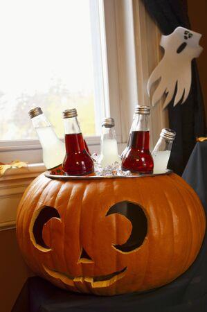 soda pops: Bottled Drinks Cooling in a Pumpkin Ice Bucket LANG_EVOIMAGES