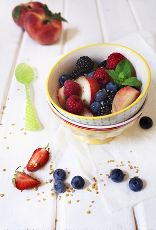 Colourful summer fruit salad with fresh mint and chopped nuts LANG_EVOIMAGES