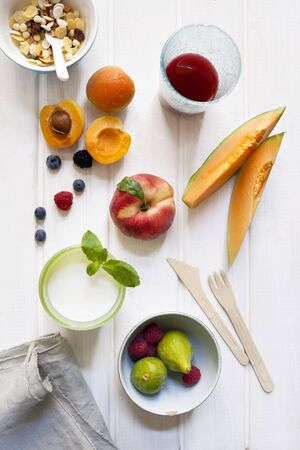 A still life of cereals, fruits, a glass of milk and fruit juice LANG_EVOIMAGES