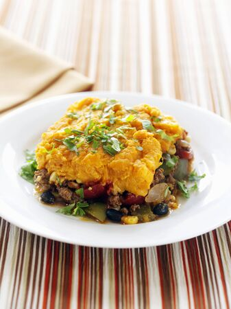 sweet course: A Serving of Shepherds Pie Topped with Sweet Potato on a White Plate