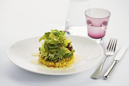 tabbouleh: Fresh lettuce leaves on tabbouleh