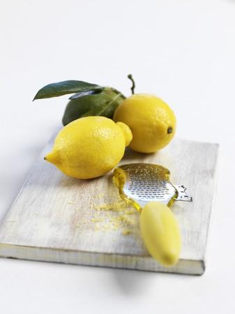 zest: Lemons and a grater with lemon zest