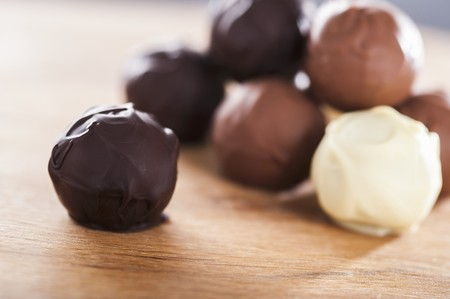 brownish: Assorted home-made chocolate truffles on a wooden table
