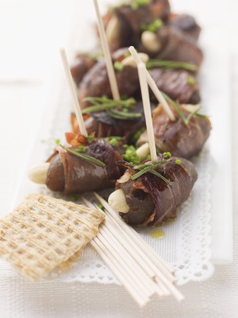 coatings: Date skewers with dry-cured ham and almonds