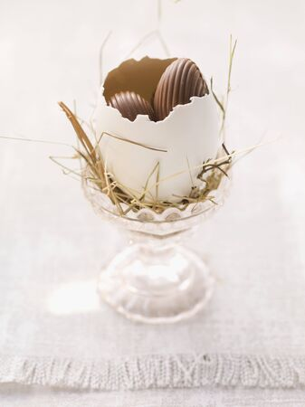 eggcup: An Easter nest in an eggcup with sweets