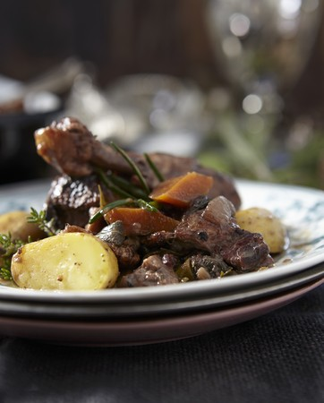 vin: Coq au vin on stacked plates