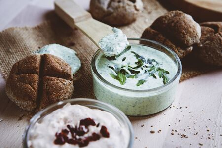spreads: Bread rolls with various spreads
