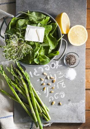 pine kernels: A still life of spinach, asparagus, cress, feta, pine nuts, lemons, salt and pepper LANG_EVOIMAGES