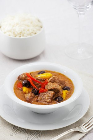 side of beef: Beef stew with peppers, black olives and a side of rice