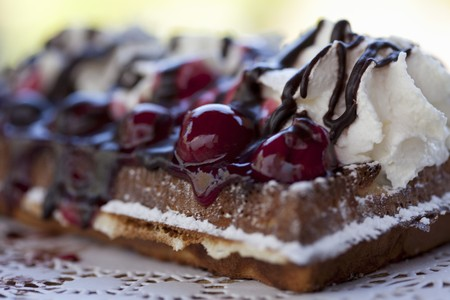doiley: Fresh waffles with cherries, cream and chocolate LANG_EVOIMAGES