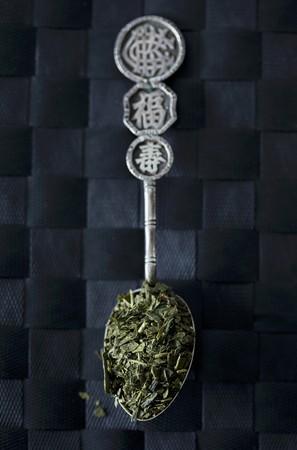 sencha tea: Sencha tea leaves on an Oriental silver spoon LANG_EVOIMAGES