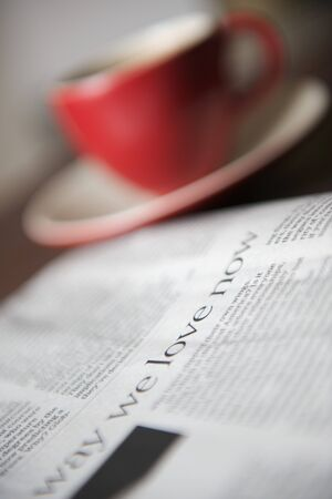coffee breaks: A daily paper next to a cup of coffee