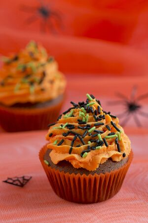 buttercream: Chocolate cupcakes with orange buttercream and sugar sprinkles for Halloween