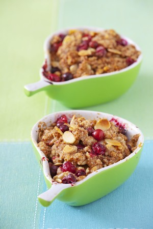 vaccinium macrocarpon: Individual cranberry crumble with almonds in pear-shaped dishes