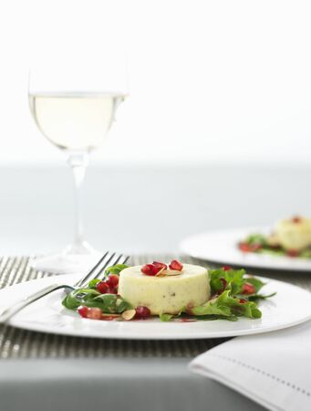 turned out: Individual Stilton tart with pomegranate seeds and rocket LANG_EVOIMAGES