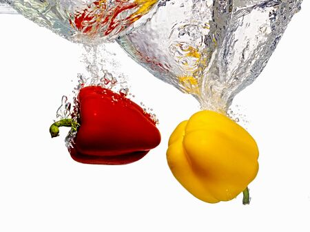 ingredients tap: Red and Yellow Bell Peppers Splashing into Water LANG_EVOIMAGES
