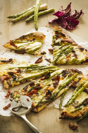 pizza cutter: Sliced Asparagus and Sun Dried Tomato Pizza with a Pizza Cutter