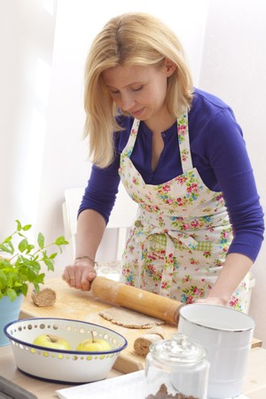 biscuit dough: Woman rolling out biscuit dough