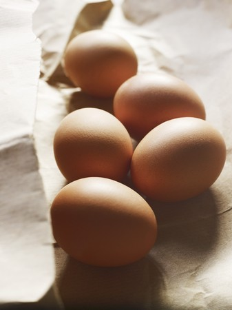 brownness: Five eggs on a piece of paper
