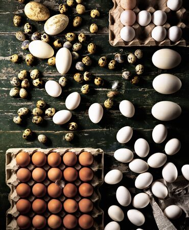 brownness: Assorted eggs on a wooden board LANG_EVOIMAGES