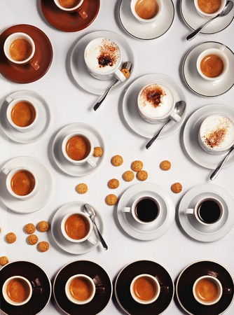 coffees: Lots of cups of espresso and cappuccino with amaretti LANG_EVOIMAGES