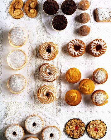 doiley: Assorted cakes and pastries on paper doilies