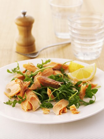 lemon wedge: Smoked trout and rocket salad garnished with a lemon wedge