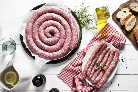 scalded sausage: Raw butifarra (Catalan sausage), olive oil, baguette and spices