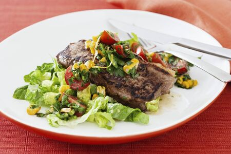 sirloin steak: Sirloin steak with salad and salsa
