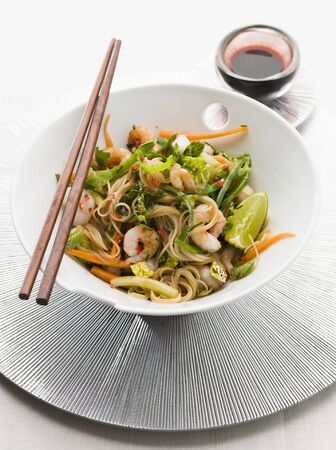 person appetizer: Noodle salad with prawns, vegetables and limes (Asia)