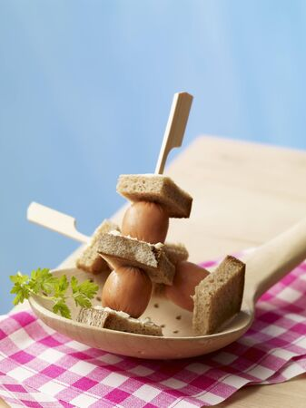 amuse: Skewers of mini bockwurst sausages with bread and butter