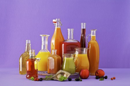 brambleberries: Freshly squeezed fruit juices in assorted glass containers against a purple background