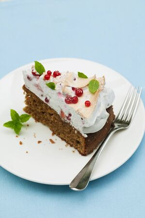 redcurrant: A slice of redcurrant cake with meringue topping and mint