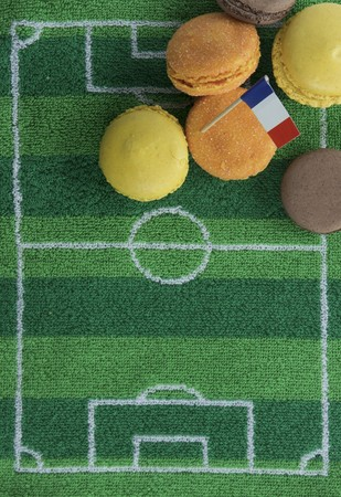 ec: Macaroons (France) with a paper flag and football-themed decoration
