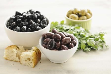 kalamata: Kalamata olives in bowls, with bread and parsley